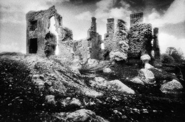 Ruins; Ruined; Remains; Abandoned; Chimneys; Stark; Glowing; Ethereal; Magical; Eerie; Mysterious; Mystery; Irish; Landscape; Architecture; Overgrown; Covered; Foliage Art Print featuring the photograph Castle Lyons by Simon Marsden