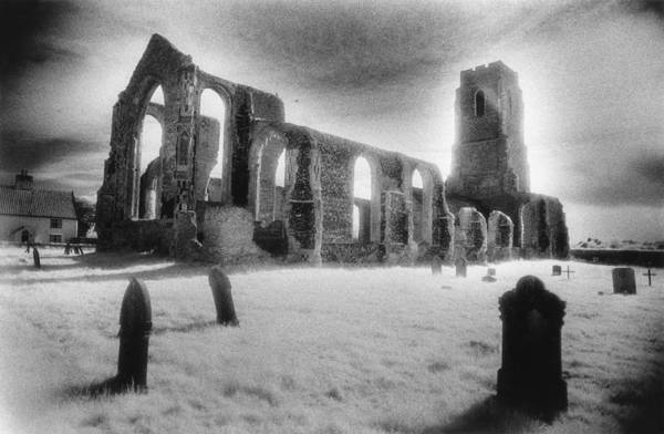 Bell Tower; Ruined; Ruin; Remains; Churchyard; Cemetery; Graveyard; Tombstones; Gravestones; Eerie; Atmospheric; Sinister; Ghostly; Dramatic; Striking; Mysterious; Gothic; Medieval; Architecture; English; Exterior; Landscape Print featuring the photograph Church Of St Andrew by Simon Marsden