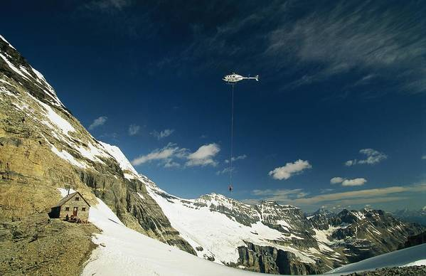 North America Art Print featuring the photograph Person Dangles From A Helicopter by Michael Melford
