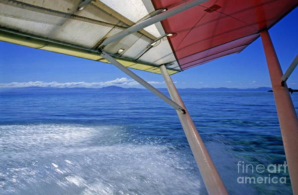 Speed Art Print featuring the photograph Wing Of A Microlite Plane Landing On Sea by Sami Sarkis