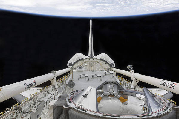 Sts-127 Art Print featuring the photograph A Partial View Of Space Shuttle by Stocktrek Images