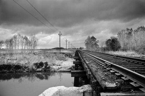 Railroad Tracks Art Print featuring the photograph Into The Distance by Matthew Angelo