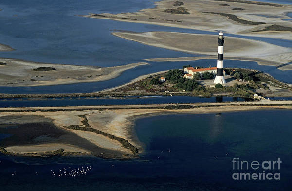 Assistance Art Print featuring the photograph La Gacholle Lighthouse Surrounded With Blue Sea In Camargue by Sami Sarkis