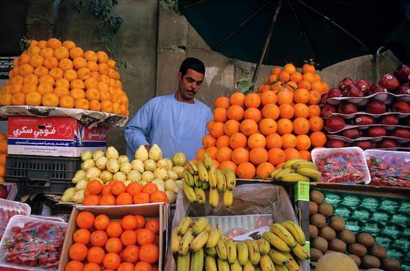 Abundance Art Print featuring the photograph Market Vendor Selling Fruit In A Bazaar by Sami Sarkis