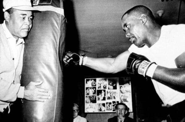 Boxer Art Print featuring the photograph Sonny Liston Working Out On The Heavy by Everett