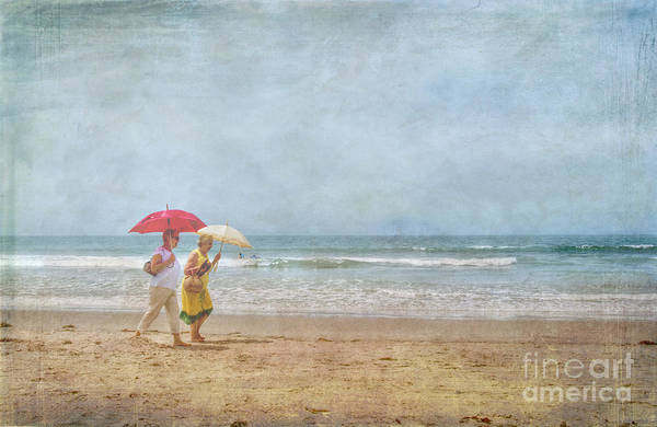 Two Elderly Women Strolling On Beach Shaded By Colorful Umbrellas Art Print featuring the photograph Strolling On The Beach by David Zanzinger