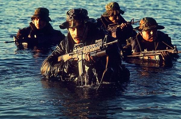 History Print featuring the photograph Us Navy Seal Team Emerges From Water by Everett