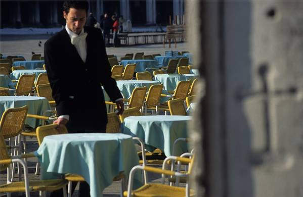 Venice Art Print featuring the photograph Waiter Preparing For The Day In Piazza San Marco In Venice by Michael Henderson