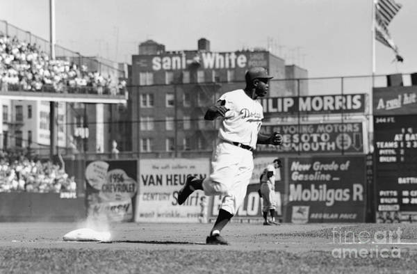 1950-1959 Art Print featuring the photograph Jackie Robinson Rounds The Bases by Robert Riger
