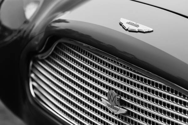 1960 Aston Martin Db4 Gt Coupe' Grille Emblem Art Print featuring the photograph 1960 Aston Martin Db4 Gt Coupe' Grille Emblem by Jill Reger