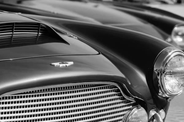1960 Aston Martin Db4 Series Ii Grille - Hood Emblem Art Print featuring the photograph 1960 Aston Martin Db4 Series II Grille - Hood Emblem by Jill Reger