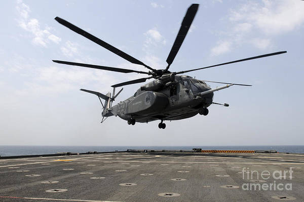 Military Art Print featuring the photograph An Mh-53e Sea Dragon Prepares To Land by Stocktrek Images