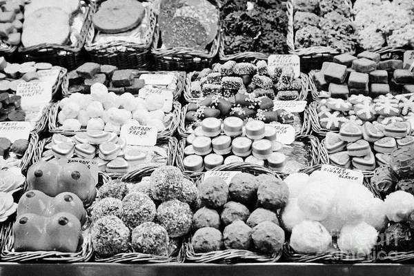 Food Art Print featuring the photograph chocolates on display inside the la boqueria market in Barcelona Catalonia Spain by Joe Fox