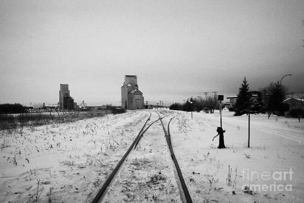 Station Art Print featuring the photograph Cn Canadian National Railway Tracks And Grain Silos Kamsack Saskatchewan Canada by Joe Fox