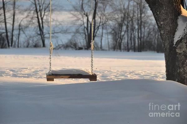 Snow Art Print featuring the photograph Empty Swing by John Black