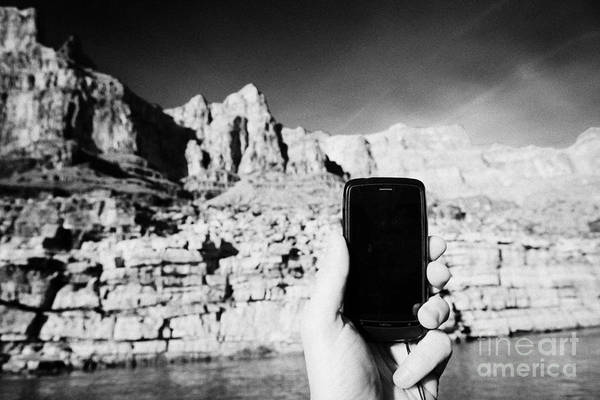 Man Art Print featuring the photograph man taking photos with smartphone during boat ride along the colorado river in the grand canyon Ariz by Joe Fox