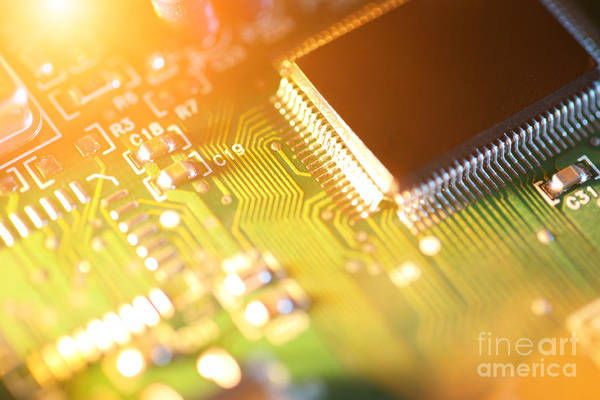 Circuit Art Print featuring the photograph Processor Chip On Circuit Board by Konstantin Sutyagin
