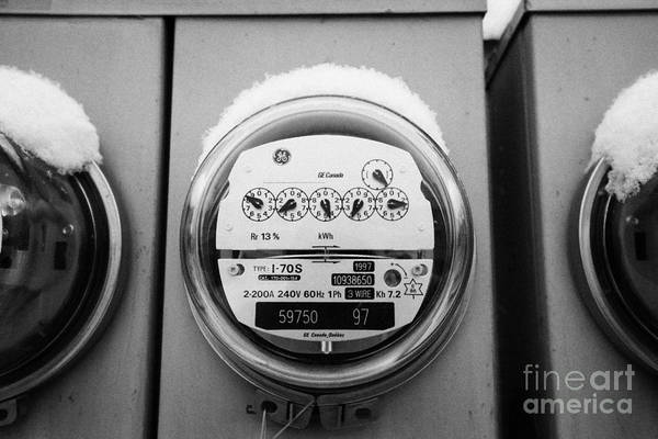 Snow Art Print featuring the photograph snow covered electricity meters in Saskatoon Saskatchewan Canada by Joe Fox