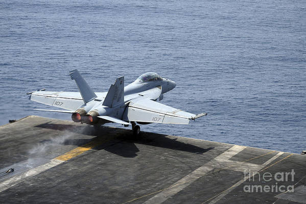 Military Art Print featuring the photograph An Fa-18f Super Hornet Launches by Stocktrek Images