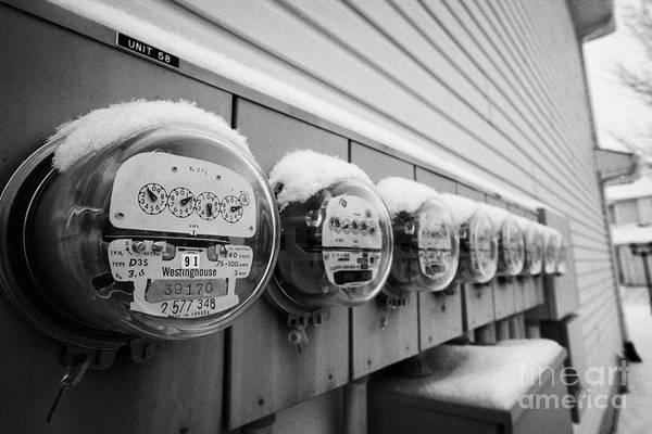 Snow Art Print featuring the photograph snow covered electricity meters in Saskatoon Saskatchewan Canada by Joe Fox