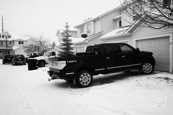 Snow Art Print featuring the photograph 4x4 Pickup Trucks Parked In Driveway In Snow Covered Residential Street During Winter Saskatoon Sask by Joe Fox