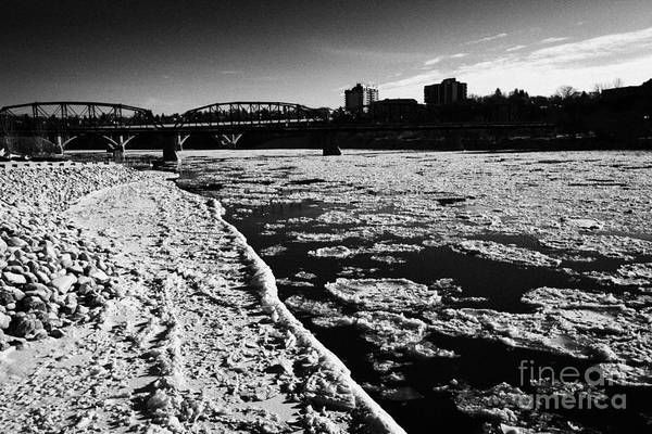 Downtown Print featuring the photograph large chunks of floating ice on the south saskatchewan river in winter flowing through downtown Sask by Joe Fox