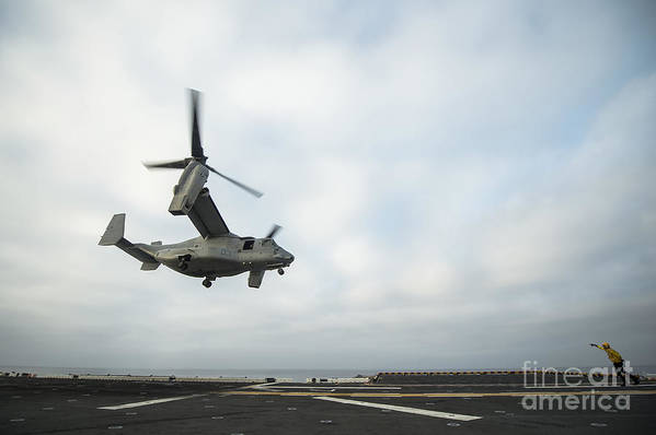 Horizontal Art Print featuring the photograph An Mv-22 Osprey Is Guided Onto by Stocktrek Images