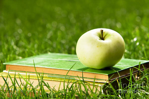 Apple Print featuring the photograph Apple On Pile Of Books On Grass by Michal Bednarek