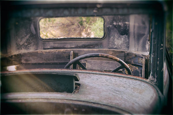 Abandoned Art Print featuring the photograph Behind The Wheel by Peter Tellone