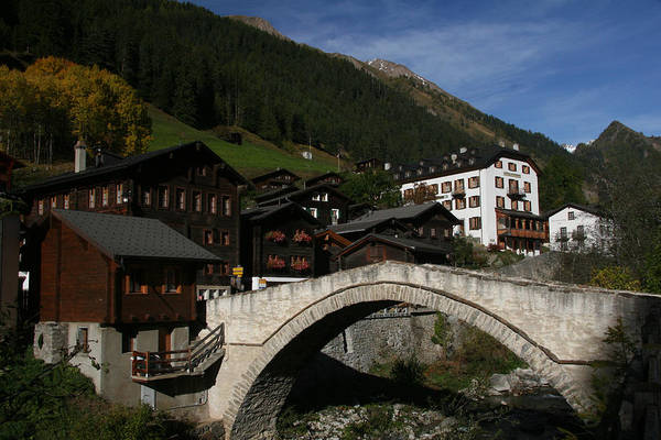 Binn In Valais Switzerland The Bogen Brucke Arched Bridge Is Listed As A Swiss Heritage Site Of National Significance Binntal Valley For Mineral And Popular With Hikers Not Photo By Michel Guntern Travelnotes Travel Er Pics Travelpics Quaint Mountain Village Old Stone Building Wood Wooden Europe European Autumn Hiking View Beside Alps Goms House Tourist Attraction Place Landmark Wallis Architecture Water Landscape River Outdoor Tree Sky Hill Tourism Color Image No People Home Day Exterior Canton Art Print featuring the photograph Binn by Travel Pics