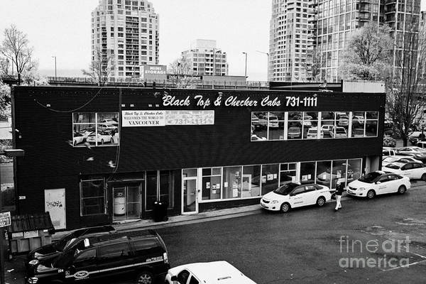 Black Print featuring the photograph black top and checker cabs office Vancouver BC Canada by Joe Fox