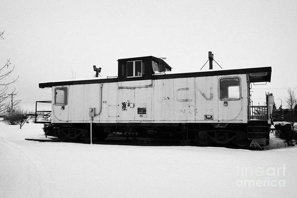 Caboose Art Print featuring the photograph Cn Caboose At Cn Trackside Gardens Used As A Community Project Kamsack Saskatchewan Canada by Joe Fox