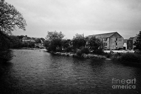 Confluence Art Print featuring the photograph Confluence Of The Rivers Cocker And Derwent On A Rainy Overcast Day Cockermouth Cumbria England by Joe Fox