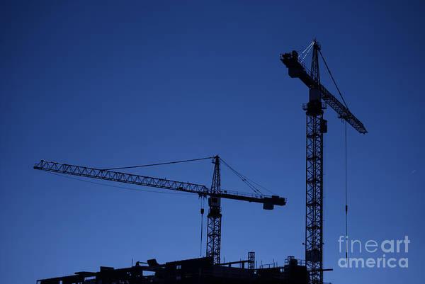 Construction Art Print featuring the photograph Construction Cranes At Dusk by Antony McAulay