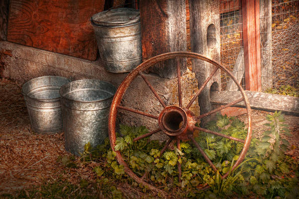 Country Art Print featuring the photograph Country - Some Dented Pails And An Old Wheel by Mike Savad