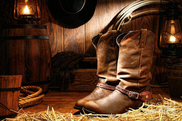 Western Art Print featuring the photograph Cowboy Boots In A Ranch Barn by Olivier Le Queinec