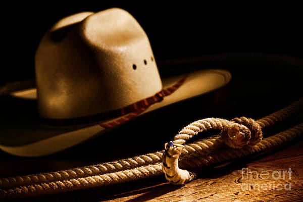 Western Print featuring the photograph Cowboy Hat And Lasso by Olivier Le Queinec