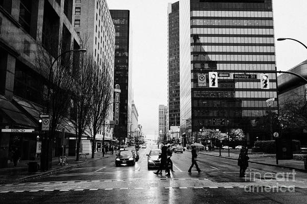 Crosswalk Art Print featuring the photograph crosswalk at west georgia and hornby downtown in the rain Vancouver BC Canada by Joe Fox