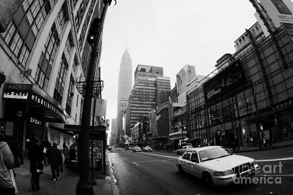 Usa Art Print featuring the photograph Empire State Building Shrouded In Mist As Yellow Cab Taxi New York City by Joe Fox