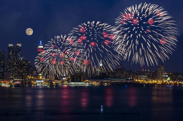4th Of July Print featuring the photograph Fireworks And Full Moon Over New York City by Susan Candelario