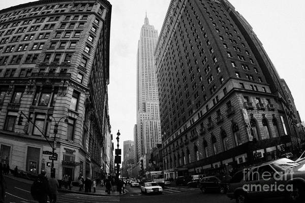 Usa Art Print featuring the photograph fisheye shot View of the empire state building from West 34th Street and Broadway junction by Joe Fox