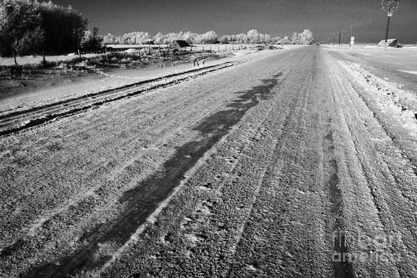 Salt Art Print featuring the photograph frozen salt and grit covered rural small road in Forget Saskatchewan Canada by Joe Fox