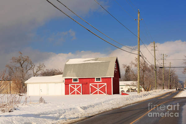 Red Art Print featuring the photograph Historic Red Barn On A Snowy Winter Day by Louise Heusinkveld