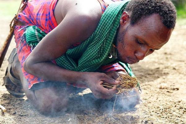 Fire Art Print featuring the photograph Maasai Fire Maker by Pat Tracey