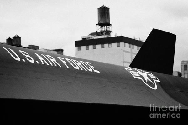Usa Art Print featuring the photograph markings on a Lockheed A12 Blackbird on the flight deck of the USS Intrepid by Joe Fox