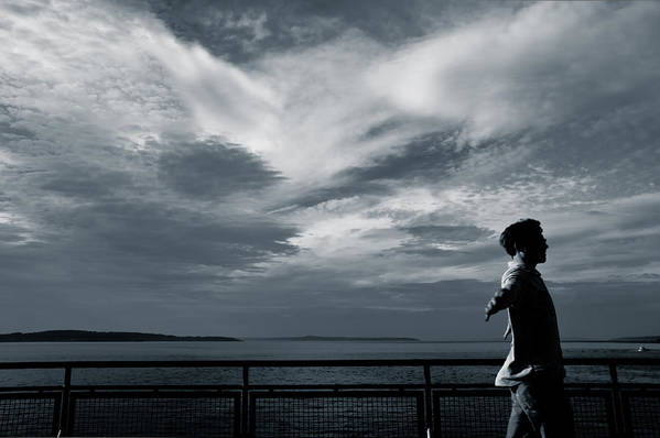 Clouds Art Print featuring the photograph Mystery Man Walks The Deck by Ronda Broatch