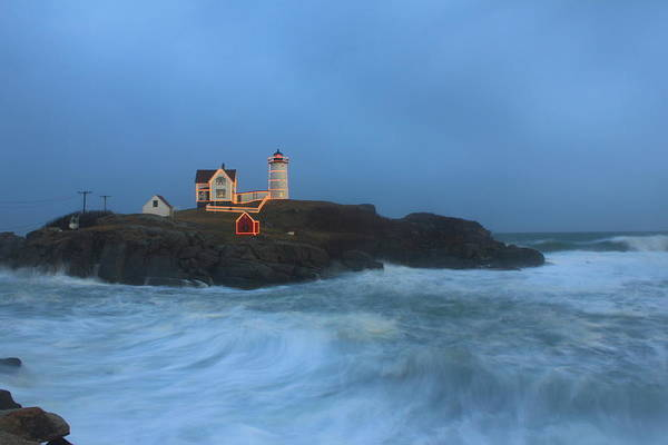 Maine Lighthouse Art Print featuring the photograph Nubble Lighthouse High Surf And Holiday Lights by John Burk