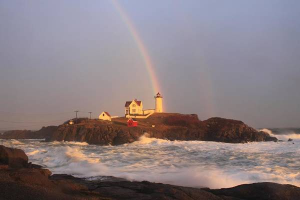 Lighthouse Art Print featuring the photograph Nubble Lighthouse Rainbow And High Surf by John Burk