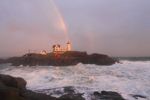 Lighthouse Print featuring the photograph Nubble Lighthouse Rainbow And Surf At Sunset by John Burk