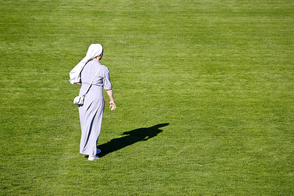 Nun Art Print featuring the photograph Nun On Green Soccer Field by Brch Photography